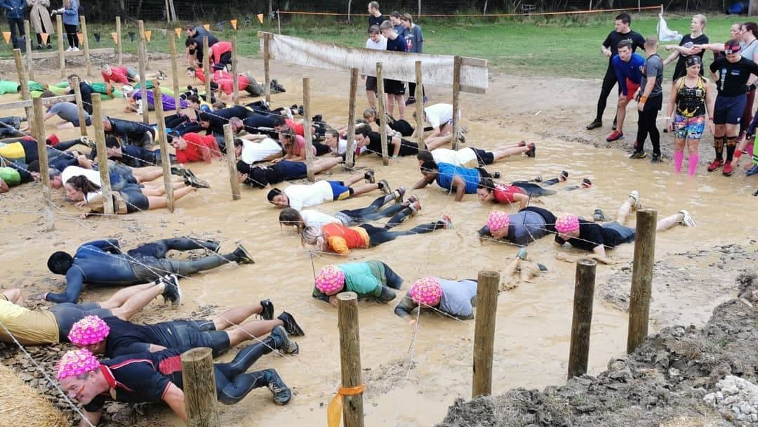 Fundraisers taking part in a Tough Mudder challenge